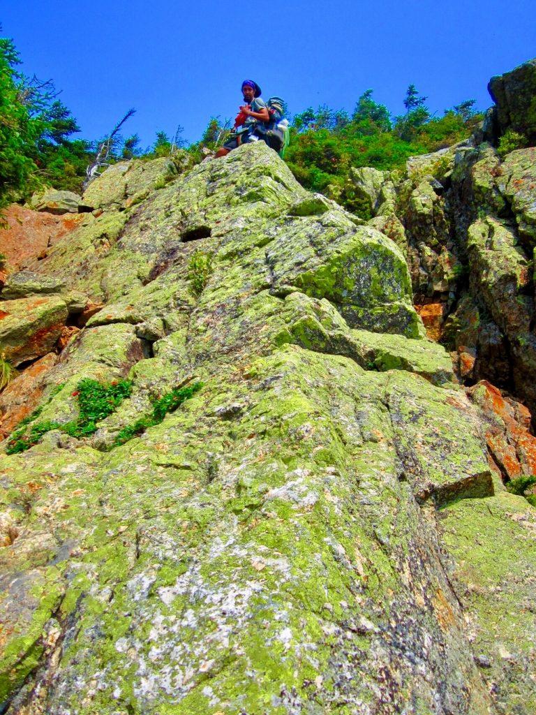 On top of a long rocky climb.