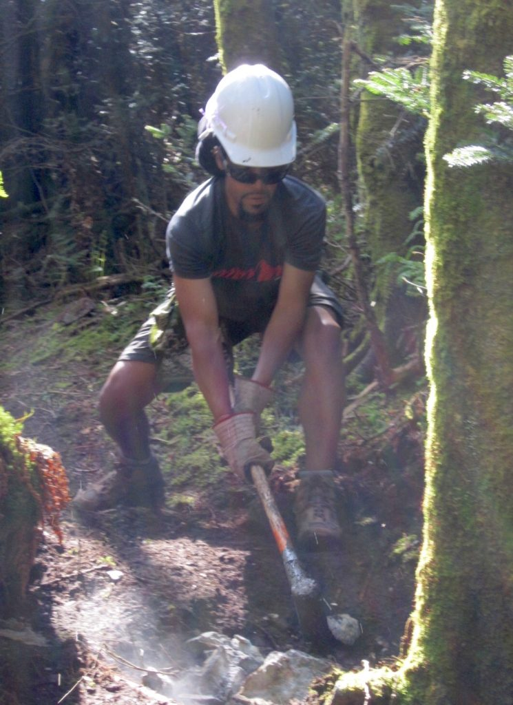 Hard Core trail maintenance. I'm wearing helmet while breaking rocks with sledgehammer.